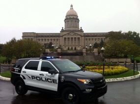 Image of an SUV Police Cruiser in front of capital building
