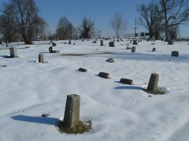 Grave markers in snow at Green Hill Cemetery