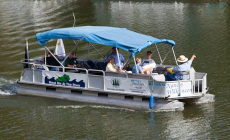 A tour boat sails down the Kentucky River