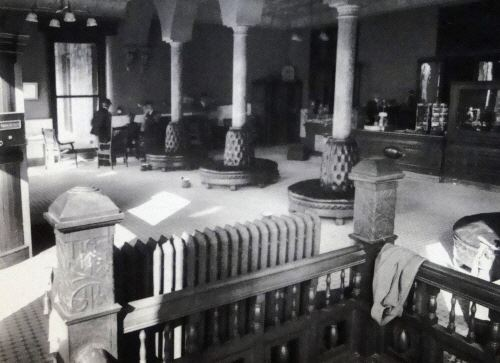Black and white image of an interior room with benches